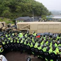 A U.S. military vehicle that is a part of the Terminal High Altitude Area Defense (THAAD) system arrives in Seongju, South Korea, on Wednesday. | REUTERS