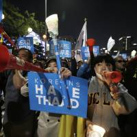 South Koreans march against deploying the THAAD missile defense system on Saturday near the U.S. Embassy in Seoul. | AP
