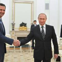 Russian President Vladimir Putin (center) meets with Syrian President Bashar Assad as Russian Foreign Minister Sergey Lavrov looks on in the Kremlin in Moscow in 2015. U.S. Secretary of State Rex Tillerson's statement Tuesday that the reign of President Bashar Assad's family 'is coming to an end' suggests Washington is taking a much more aggressive approach about the Syrian leader. Taking him out of the equation without a clear transition plan would be a major gamble. | ALEXEI DRUZHININ, SPUTNIK, KREMLIN POOL PHOTO / VIA AP, FILE
