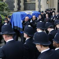 British police honor officer slain by terrorist outside Parliament