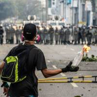 Venezuela protesters demand Maduro slate elections, are tear-gassed