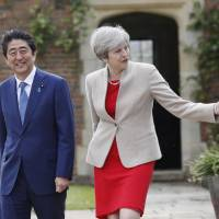 Abe and May agree to preserve free trade and unite on North Korea