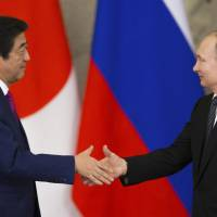 Isle row breakthrough eludes Putin-Abe talks but Moscow offers to fly kin to visit graves