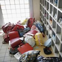Students were evacuated from an elementary school in Futaba, Fukushima Prefecture, soon after the huge earthquake in the region in March 2011. | KYODO