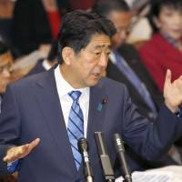 Prime Minister Shinzo Abe responds to questions over a controversial land deal with nationalist school operator Moritomo Gakuen in the Diet last month. | KYODO