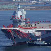 China's first domestically produced aircraft carrier, known as the Type 001A, is seen during a launch ceremony at Dalian shipyard in Dalian, northeast China's Liaoning Province, on Wednesday. | AFP-JIJI