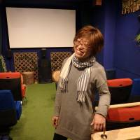 Chihoko Hiratsuka, founder of Cinema Chupki Tabata, is interviewed March 24 in the movie theater's seating area. | KYODO