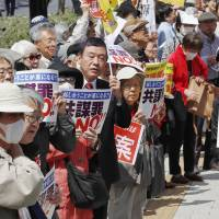 Protesters gather near the Diet on Thursday as the Lower House kicked off deliberations on yet another contentious conspiracy bill. | KYODO