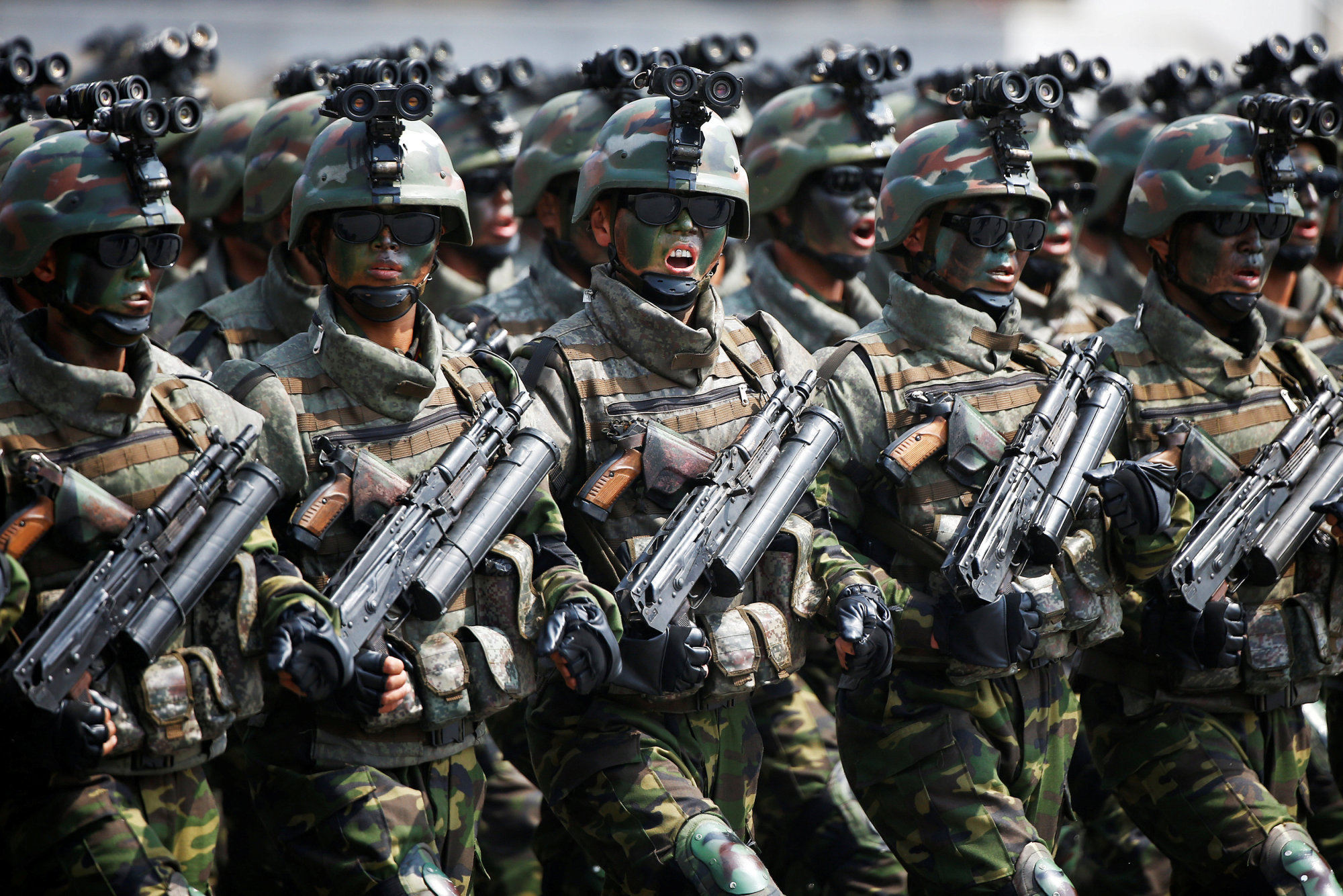 North Korean special forces soldiers march and shout slogans during a military parade marking the 105th anniversary of the birth of the country's founder, Kim Il Sung, in Pyongyang on April 15. | REUTERS