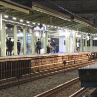 Two elderly women die holding hands as they jump in front of commuter train