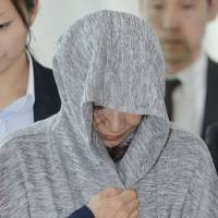 Japanese woman accused of defrauding dozens extradited from Thailand