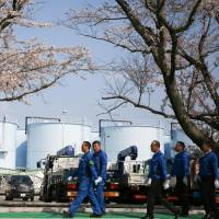 Six years later, some workers at Fukushima nuclear plant say they can do without protective gear