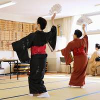 Hiroko Sawada (left) teaches Japanese traditional dance to her students in Sapporo on March 2. | KYODO