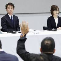 DeNA Co. President Isao Moriyasu (left) and Tomoko Namba, founder and chairman, hold a news conference in Tokyo on March 13. | KYODO