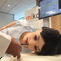 Mikoto, a simulation robot developed for students, young doctors and emergency care workers to practice medical procedures on is unveiled in Tokyo on March 24. | TOMOKO OTAKE