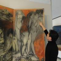 Yukinori Okamura, a curator for the Maruki Gallery for the Hiroshima Panels, points to a damaged part of the artwork at the gallery in Higashimatsuyama, Saitama Prefecture, on Thursday. | KYODO