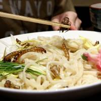 The main event on Ramen Nagi's one-day event: ramen noodles topped with fried worms and crickets. | REUTERS