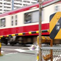 Man killed in failed rescue bid at rail crossing identified as Yokohama Bank employee