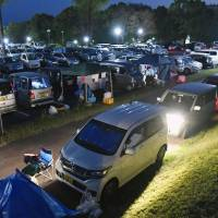 A parking lot in the town of Mashiki, Kumamoto Prefecture, is packed with vehicles after strong earthquakes hit the region in April 2016. | KYODO