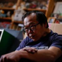 Akihiro Karube, 53, who was diagnosed with Parkinson's disease and had to quit his job, says he now relies on his father's pension and a disability pension of his own. | REUTERS