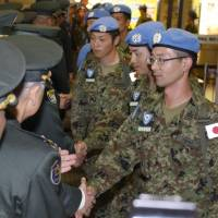Ground Self-Defense Force members returning from a U.N. peacekeeping mission in South Sudan arrive at Aomori Airport in Aomori Prefecture on Wednesday. | KYODO