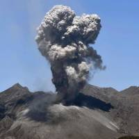Mount Sakurajima's latest eruption is seen from Tarumizu, Kagoshima Prefecture, at 11:02 a.m. on Friday. | KYODO