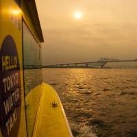 A Tokyo Water Taxi vessel travels toward the Gate Bridge in Tokyo Bay. | ROB GILHOOLY