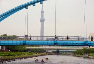 Kayakers on the Kyunaka River pass under a bridge in Tokyo's Koto Ward.