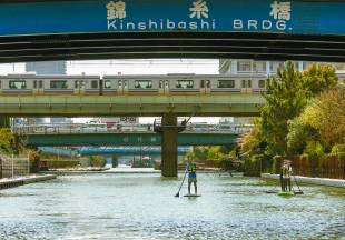 Paddle boarders take to the waters of Yokojuken River in Tokyo.