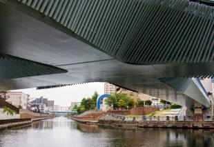 The underside of the cross-shaped Clover Bridge in Koto Ward.