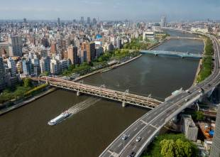 A river cruiser travels down the Sumida River in Tokyo. Rob Gilhooly