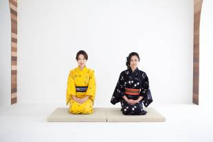 A woman sits in a seiza position.