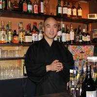 What'll it be?: Yoshinobu Fujioka stands ready to serve at Vowz Bar. | KYODO