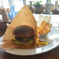 A little off the top: The Mexican burger holds court at Burlesque, which offers both burgers and haircuts. | J.J. O'DONOGHUE