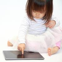 Toddlers playing with touchscreens sleep less