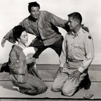 Best of intentions, worst of outcomes: Sakini (Marlon Brando) hovers over Lotus Blossom (Machiko Kyo) and Captain Fisby (Glenn Ford) in a publicity shot for 'The Teahouse of the August Moon.' | MGM [PUBLIC DOMAIN]
