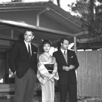 Left to right: Glenn Ford, Machiko Kyo and Marlon Brando pose for photos on the set of 'The Teahouse of the August Moon' in Osaka in 1936.   KYODO