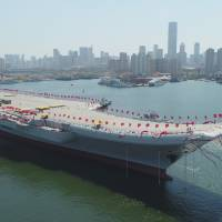 China launched its first domestically built aircraft carrier Wednesday, demonstrating the growing capabilities of its defense industries. | AP