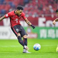 Urawa's Rafael Silva scores a first-half goal against Shanghai SIPG in an Asian Champions League match on Tuesday at Saitama Stadium. The Reds won 1-0. | KYODO