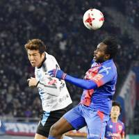 Peter Utaka heads the ball during FC Tokyo's 3-0 win over Kawasaki Frontale last month. | KYODO