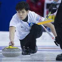 Japan men split pair of matches at curling worlds