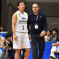 Sunrockers Shibuya bench boss BT Toews, seen speaking to guard Taishiro Shimizu during a recent game, willingly listens to his players and is open to their suggestions, according to center Robert Sacre. | B. LEAGUE