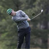Hoffman fires 65 to lead Masters