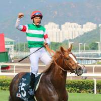 Joao Moreira celebrates his win aboard Neorealism at the Audemars Piquet Queen Elizabeth II Cup in Hong Kong on Sunday.   KYODO