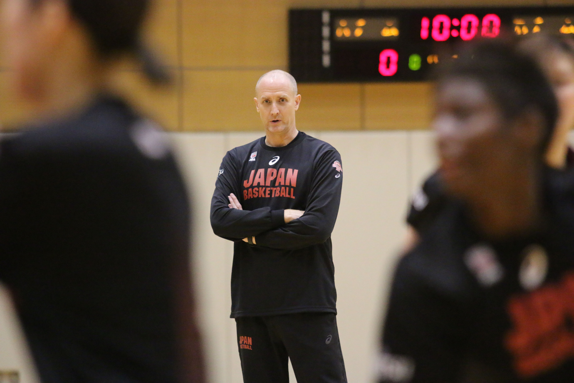 Japan women's basketball coach Tom Hovasse watches his team practice at the National Training Center in Tokyo earlier this week. | KAZ NAGATSUKA