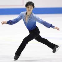 Shoma Uno performs his short program at the World Team Trophy on Thursday at Yoyogi National Gymnasium. Uno leads the men's competition with 103.53 points. | KYODO