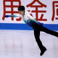 Yuzuru Hanyu triumphs in the men's free skate on Friday night with 200.49 points at the World Team Trophy at Yoyogi National Gymnasium. | REUTERS