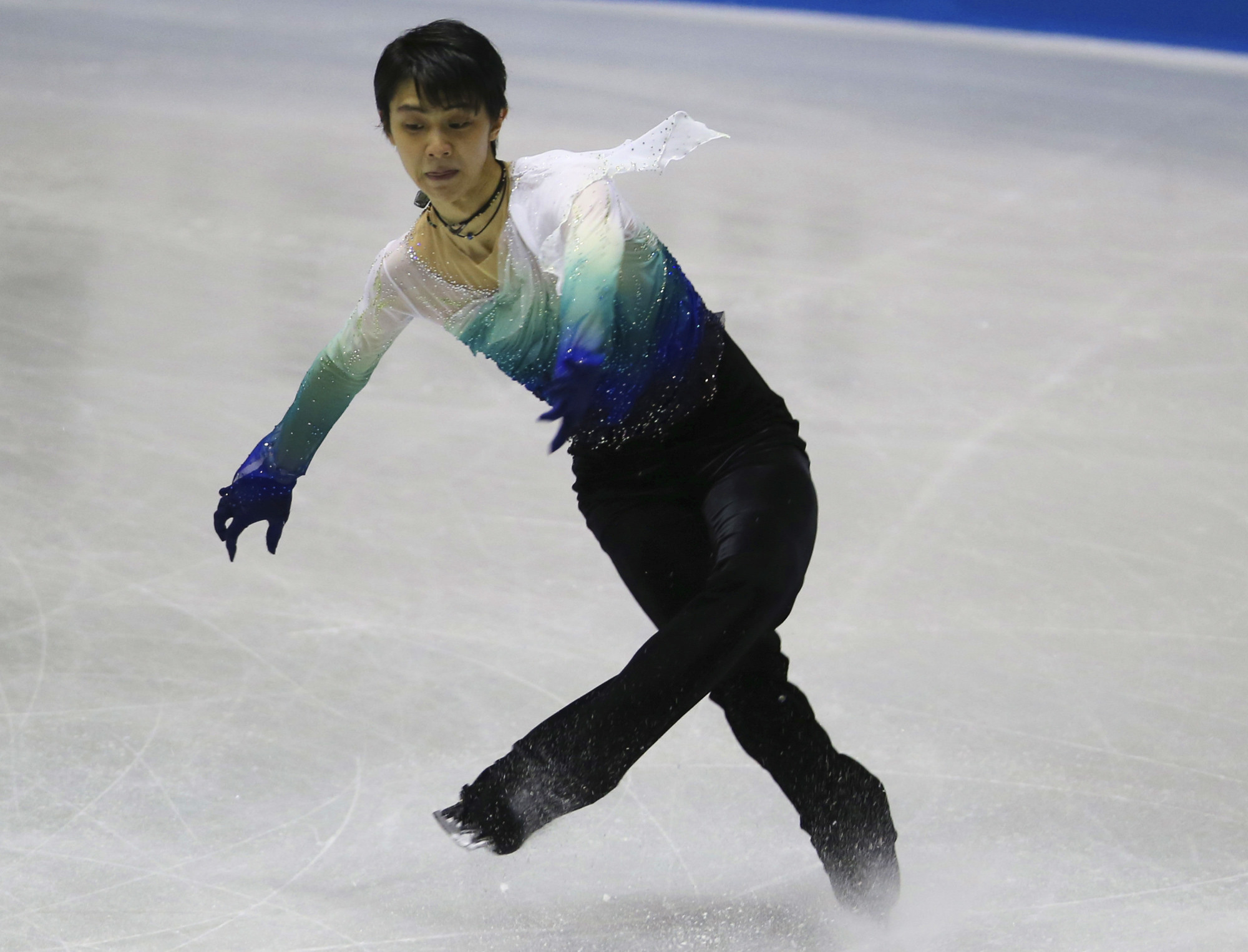 World champion Yuzuru Hanyu attempted five quadruple jumps during his free skate on Friday night at the World Team Trophy in Tokyo. Hanyu is considering having five quads in his free skate for the Olympic season. | AP