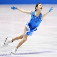 Two-time defending world champion Evgenia Medvedeva dazzles the crowd with a world-record score of 80.05 points in the women's short program on Thursday night. | KYODO