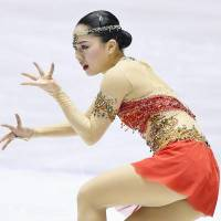 Wakaba Higuchi sets a personal-best score (145.30), hitting seven triple jumps in Saturday's free skate. | KYODO